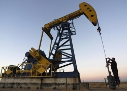 UPDATE 4-Oil slips below $55 as dollar, Libyan production boost weigh