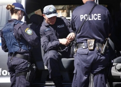 Australian police charge man over New Year's Eve threats in Sydney